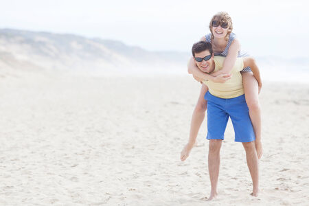 loving couple at the beach together having fun photo