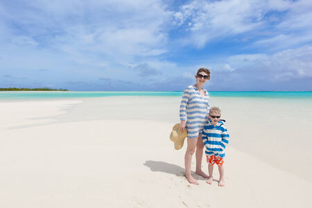 motu: beautiful mother and her son at the gorgeous beach at aitutaki, cook islands