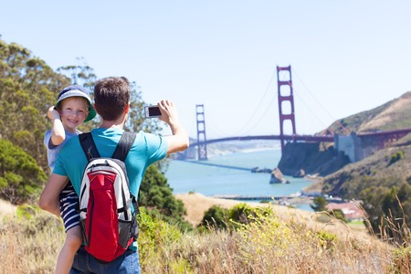 san francisco golden gate bridge: family of two exploring san francisco and golden gate bridge, taking picture of it Stock Photo