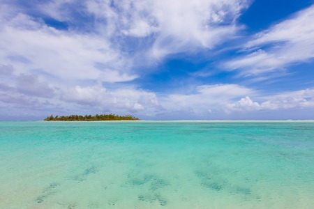 motu: view at perfect tropical island, surrounding turquoise lagoon and blue sky Stock Photo