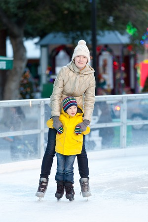 family of two ice skating together photo