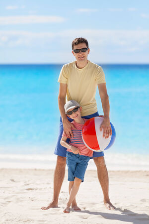 family of two enjoying vacation time together at the caribbean beach photo