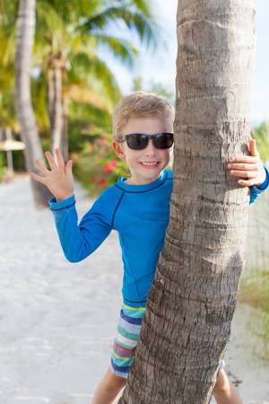beautiful little boy having fun at the beach, vacation concept photo