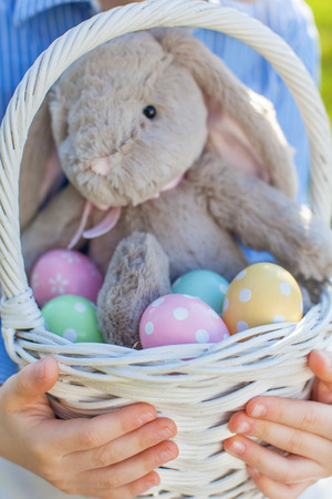 close-up of easter basket with colorful eggs and bunny at spring time photo