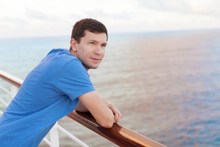 young handsome man enjoying vacation at cruise ship photo