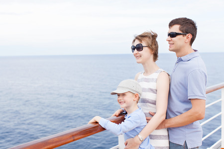family of three enjoying vacation at cruise ship Stock Photo