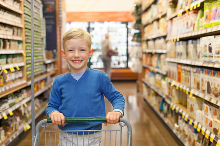 little and proud boy helping with grocery shopping, healthy lifestyle concept Reklamní fotografie