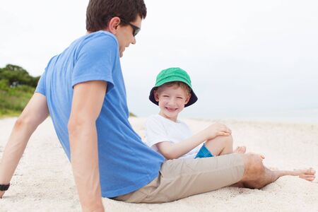 fun day: father and his son spending fun day together at the beach at taketomi islands, okinawa, japan Stock Photo