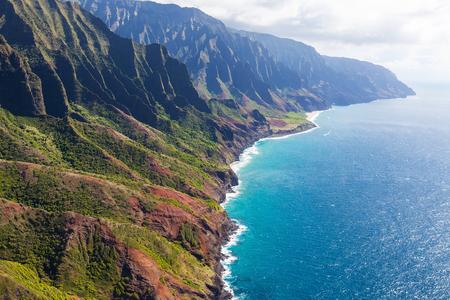 ridge of wave: stunning aerial view of na pali coast at kauai island, hawaii from helicopter Stock Photo