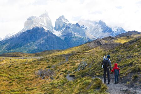 torres del paine: family of two, father and son, enjoying hiking in torres del paine national park, patagonia, chile Stock Photo