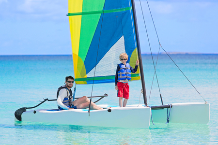 family of two, father and son, enjoying sailing together at hobie cat catamaran, active healthy lifestyle Stock Photo