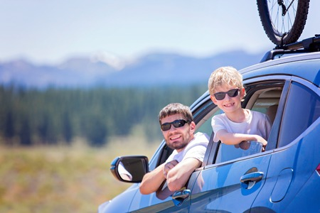 sierra nevada: happy family of two, young father and his son, looking out of the car enjoying road trip and active vacation together Stock Photo