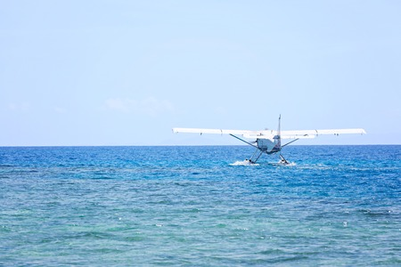 seaplane landing on water, copy space on left