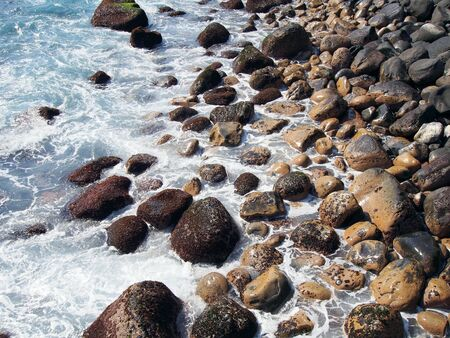 The coast where the boulders are washed