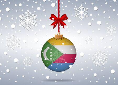 comoros: christmas background with comoros flag ball Illustration
