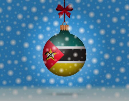 mozambique: snowfall and snowball with flag of mozambique