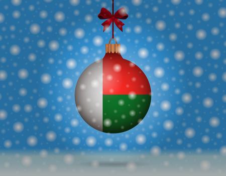 boule de neige: chutes de neige et boule de neige avec le drapeau de Madagascar
