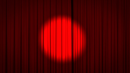 Red stage curtain with a spotlight in the center. Stock Photo