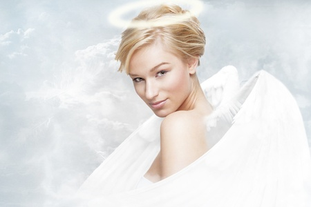 Gorgeous young woman as angel with white wings and aureole Stock Photo - 11957884