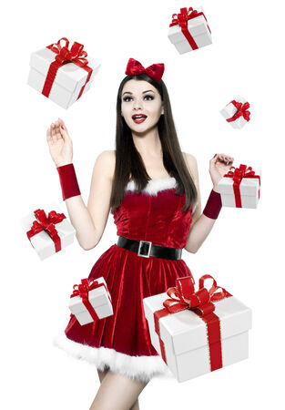 Beautiful youn brunette woman with many gifts - christmas portrait photo