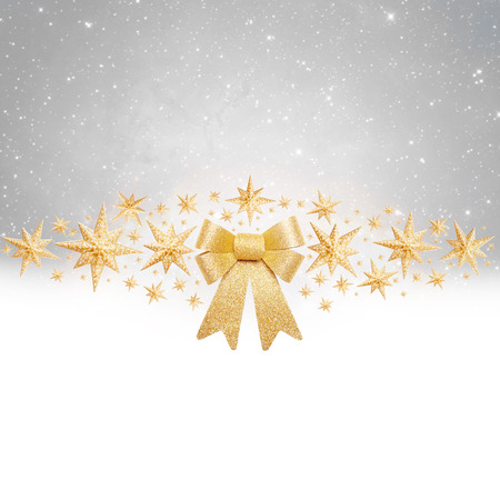 golden ribbon: Christas background - golden bow and stars on silver background Stock Photo