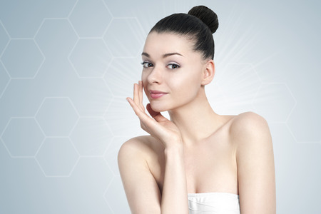 beauty care: Beautiful young brunette woman portrait - skin care concept