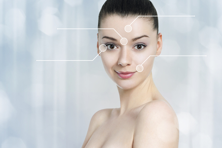 anti wrinkles: Beautiful brunette woman pointed wrinkles spots. Anti agingtreatment  - concept Stock Photo