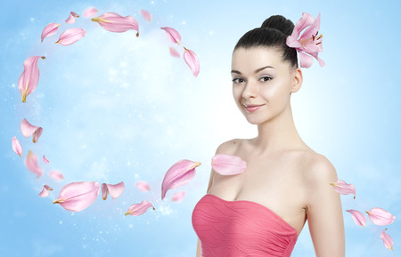 healthy skin: Beautiful brunette woman with flower petals - body and skin care concept Stock Photo
