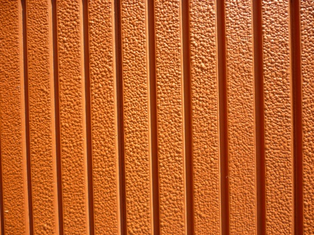 texture walls with a bright orange color for background purpose photo