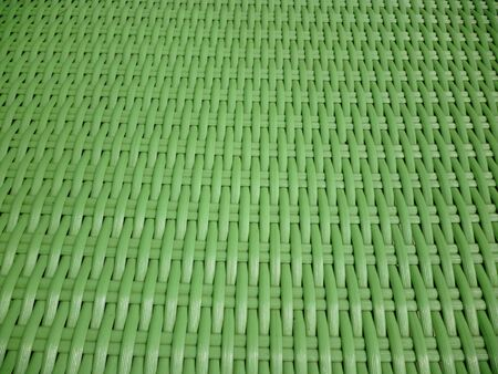rattan: A seamless Synthetic rattan furniture background that texture tiles as a pattern in any direction