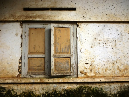window of an old house in Indonesia are not neglected photo