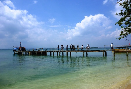 number of visitors crossing a small bridge in Panjang island photo