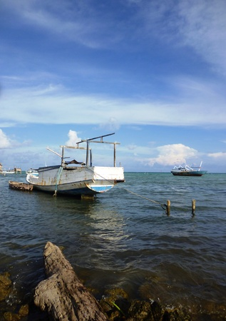 boats moored on the beach in Karimun Java photo