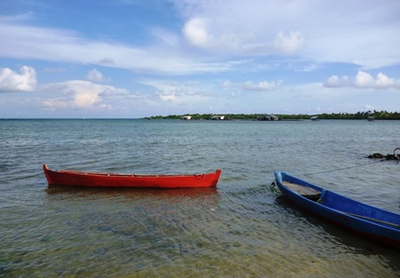 crossings: 2 pieces of the boat rests on the beach on the island of Java Karimun