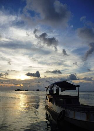 crossings: ship on shore on the island of Java Karimun