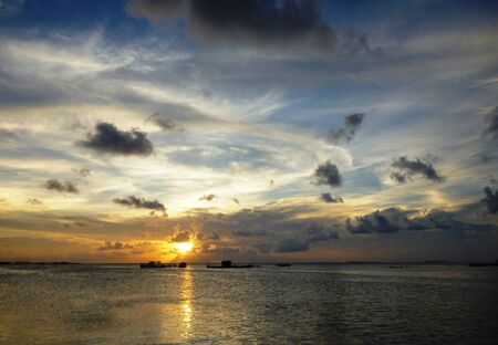 promontory: beautiful sunset at beach located on the Promontory of the island of Java Karimun