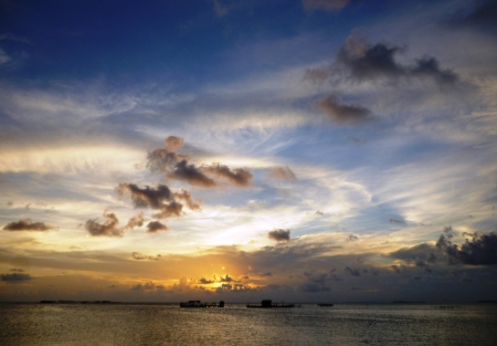 beautiful sunset at beach located on the Promontory of the island of Java Karimun photo