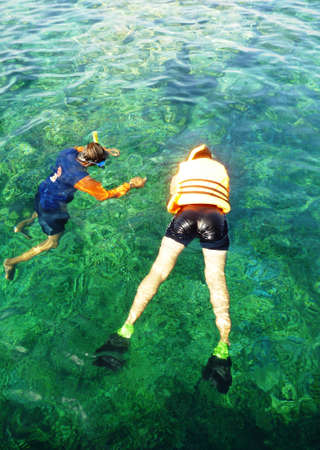 play snorkeling in the waters Karimun Java, Jepara, Indonesia photo