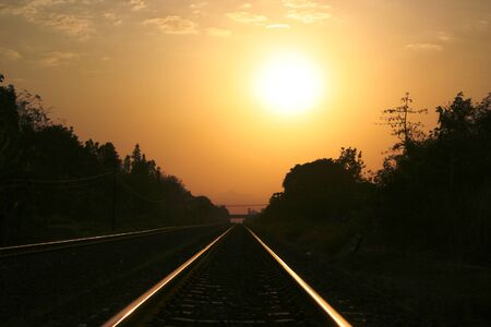 sunset over the railroad tracks in Yogyakarta, Indonesia