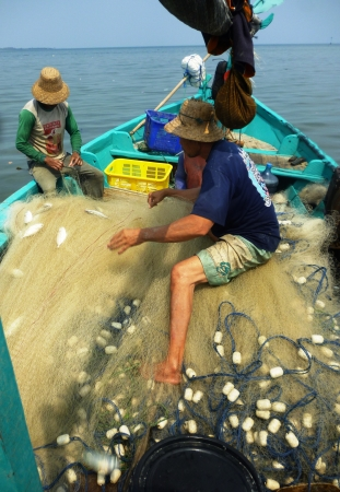 the fishermen picked up in the net catches