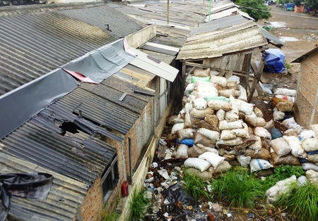 excremental: piles of garbage in the back of a traditional market in Indonesia Stock Photo