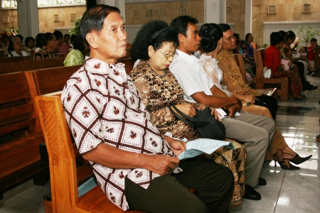 baptized: prosession being baptized in catholic church in Yogyakarta, Indonesia