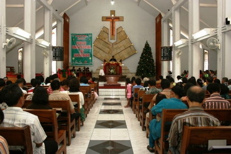 prosession being baptized in catholic church in Yogyakarta, Indonesia