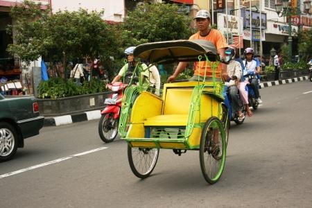 jogjakarta: jogja rickshaw around Malioboro street , Yogyakarta Editorial