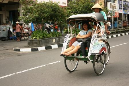 jogja rickshaw around Malioboro street , Yogyakarta 新闻类图片