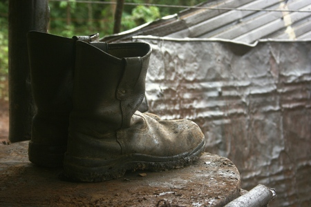 shoes on installation and traditional petroleum mining operations in Cepu, Indonesia  photo