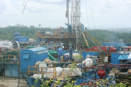 installation and traditional petroleum mining operations in Cepu, Indonesia