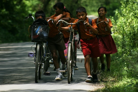 elementary school students in remote areas in Indonesia bike ride to home