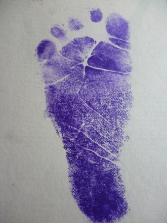 stamp your foot on the baby s birth certificate