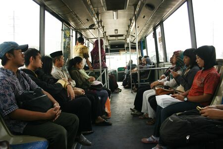 Large group of People going by bus in semarang, indonesia
